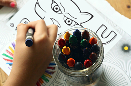 Kid coloring in TK coloring page