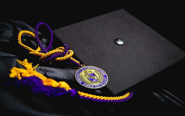UNI gown, cap and tassels