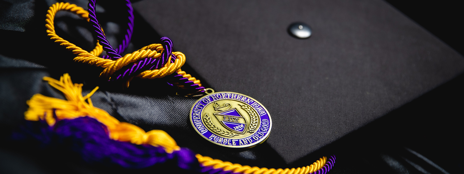 UNI cap, gown and tassels